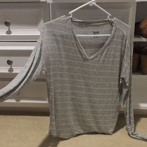 Long sleeve grey top with white and silver glitter